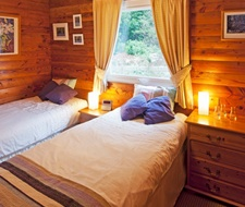One of two comfortable twin bedrooms with forest or mountain views