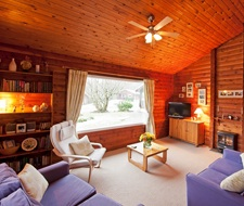 The lounge at Feorag Lodge offers lots of amenities and stunning views over to the mountains
