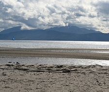 The profile of The Sleeping Warrior is a well-known landmark on the Isle of Arran. Seen here from beautiful Kilbride Bay (aka Ostel Bay) at the southern end of Cowal. 90 minutes from Feòrag Lodge